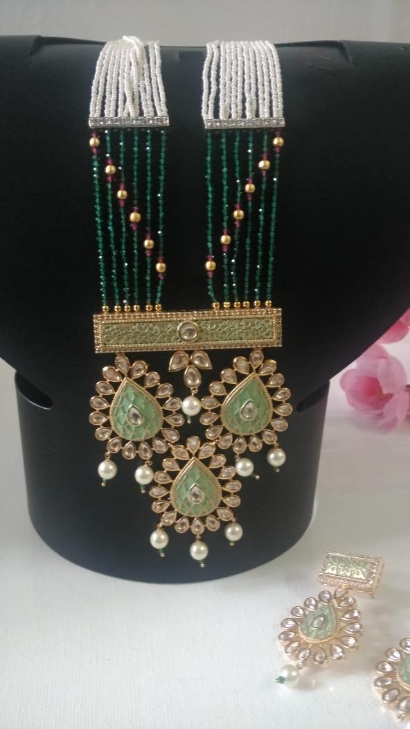Delicate rice pearls, kundan and meenakari design necklace set in German silver with golden Matt finish
